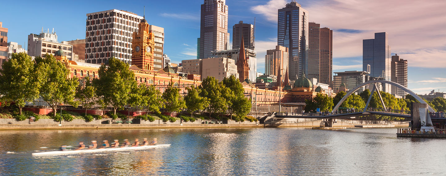 Looking across the Yarra River with rowers training on a early morning